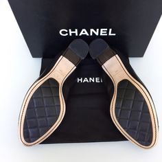 """Chanel Spirit Pumps These chic and fun authentic Chanel Spirit Pumps are a great addition to any wardrobe! Shoes feature black leather with black patent leather toe caps & """"CC"""" logos are embroidered on the side of each shoe. The elastic around the opening of the shoe make these heels comfortable & easy to slide on & off. Leather-lined uppers & leather/rubber soles for a comfortable fit & a touch of class. These have never been worn out of the house & come with dust bag & box. Heel: 2.25""""…"""