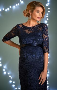 Our Amelia maternity dress is a Tiffany Rose signature style, now in soft navy lace with a lustrous shimmer. Incredibly comfortable and flattering with gentle give in the body balanced with elegant boat neck and ¾ sleeves.