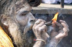 Maha Shivaratri Festival - Nepal / Hindu Religious Festival. A Sadhu (Hindu holy man) smokes marijuana using a chillum, a traditional clay pipe, as a holy offering for Lord Shiva, the Hindu god of creation & destruction, near the Pashupatinath Temple, Kathmandu, Nepal, 9 March 2013. (Photo credit: PRAKASH MATHEMA /  AFP / Getty Images)    http://www.huffingtonpost.com/2013/03/11/shivaratri-festival-nepal-mairijuan_n_2851875.html    video: https://www.youtube.com/watch?v=3QNMiFgvvm4