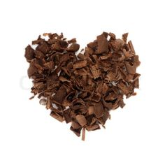 Stock image of 'Chocolate love. Chocolate chips, folded in the shape of the heart.'