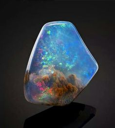 This gorgeous opal looks like it has a nebula inside it Lava Lamp, Rocks And Minerals, Crystals Minerals, Crystals And Gemstones, Stones And Crystals, Luz Opal, Aqua Aura Quartz, Quartz Cluster, Télescope Hubble