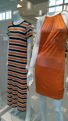 Michael KorsoOrange halter dress with gold chain neckline.  Orange, blue, and white stripe maxi t-shirt dress.