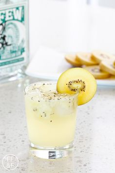 kiwi gin fizz 2 slices of Kiwi, peeled plus extra for garnish 2 teaspoons honey 2 ounces FEW American Gin Soda Water Ice Instructions Muddle the kiwi in a tumbler glass. Add the honey, gin and ice to the glass. Fill the glass with soda water. Stir to combine. Serve with a kiwi slice.
