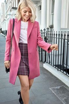 The first image from the campaign, pictured, shows Holly wearing the tailored pink coat with the checked skirt, t-shirt printed with the words 'merci Paris', the black tassel bag and black ankle boots for a look totalling Outfits Otoño, Stylish Outfits, Fashion Outfits, Womens Fashion, Fashion Clothes, Unique Outfits, Fashion Fall, Work Fashion, High Street Fashion