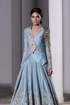 Ice Blue Trail Lehenga & Jacket Set is part of Lehenga blouse designs - Ice Blue hand embroidered trail lehenga with a jacket set Fabric Raw Silk Care Dry Clean Only Choli Designs, Lehenga Designs, Kurta Designs, Blouse Designs, Indian Designer Outfits, Designer Gowns, Indian Outfits, Designer Jackets, Designer Wear