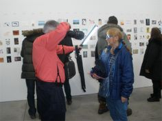 Artist Rossella BLUE Mocerino being photographed at the preview of Postcards from the Edge, a benefit for VISUAL Aids, 2014. #nycart #womenartists