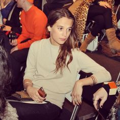 Alicia Vikander. Notice the nail polish, jewelry and minimal makeup/subtle clothing