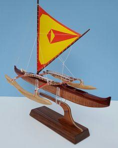 An older Hawaiian racing canoe retrofitted with a new sail.