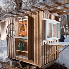 Gypsy Junker, a 24 square-foot tiny house made out of shipping pallets, castoff storm windows and discarded kitchen cabinets!