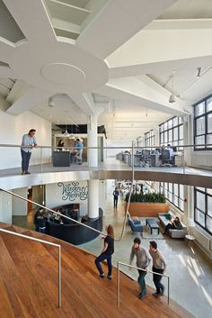 WORKac's design for the New York offices of Wieden+Kennedy. The 50,000 sq ft New York office embraces urban density as its motto: a minimal compression of individual work spaces that opens up room for a gradient of diverse collective spaces.