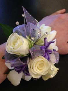 Prom corsage, white roses, white orchids, purple hyacinth, purple ribbon and gems White Rose Boutonniere, Prom Corsage And Boutonniere, Corsage Wedding, Wedding Bouquets, Orchid Corsages, Flower Corsage, Wrist Corsage, Homecoming Flowers, Prom Flowers