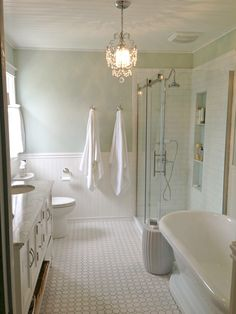 Golden Boys and Me: Master Bathroom with pedestal tub, white subway tile, carrera (with sources)
