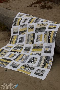 "Radio Way from Jaybird Quilts. Gray, yellow, black & white quilt; uses 2 1/2"" strips."