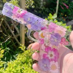 A gun made from epoxy resin and dried flowers. Not to be used as a weapon - this does not fire bullets. It is purely an aesthetic art piece. Diy Resin Art, Diy Resin Crafts, Creepy Cute Fashion, Gun Aesthetic, Mode Poster, Pretty Knives, Pastel Punk, Kawaii Accessories, Iphone Wallpaper