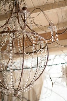 Rough Luxe Fall Chandelier. simple and rustic iron with crystal beeds