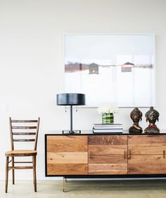 Living space with a wood credenza and black lamp