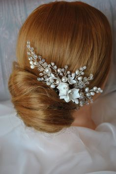 Delicate bridal comb the hightest quality has handcrafted with silver-plated wire (non-tarnish), freshwater pearl, Swarovski crystal pearl, shatons, flowers (polimer clay). It will bring your hairstyle a festive touch, lightness, perfection. It easily fix and look fresh. Classic hairpiece for your wedding hairstyle.   Dimensions: 6 inches in lenght  Most orders are delivered within the following timeframe: 5-7 business days for Russia, 10-14 business days in EU 12-17 business days USA 25-45…