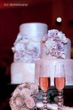 beige wedding cakes with pastel color flowers