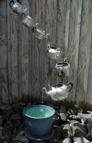 Rain chime made from old tea pots