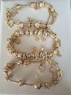 Pandora gold bracelet and gold charms