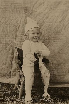 +~+~ Antique Photograph ~+~+ Bursting with Happiness - little boy opening Christmas stocking. Circa 1900