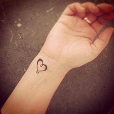 Simple heart tattoo on wrist.