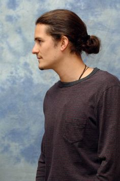 Men's long hair style - or with hair loose in a pony tail, but slicked back tight.