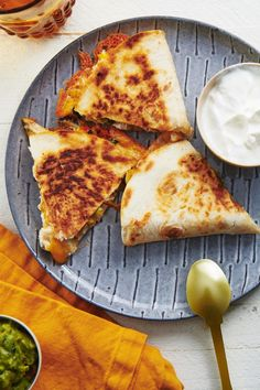 Overstuffed Chicken and Vegetable Quesadillas Recipe / These quesadillas are jammed with a medley of vegetables and shredded chicken, and then it's all bound together with a pile of cheese. #easyrecipes #familyfriendly #mealprep #kidapproved #familyfavorite Braised Lamb Shoulder, Shoulder Roast, Ground Beef Quesadillas, Quesadilla Recipes, Quesadilla Chicken, Vegetarian Quesadilla, Mustard Pork Chops, Shrimp And Rice, Fried Shrimp