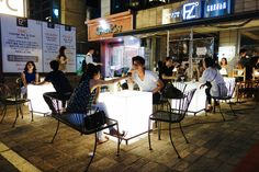 Tables a glow - Located around Sangsu Station is a popular pub called Fuzzle Heaven. During the summer time, the pub has special tables that light up the evening. Couples often come here for drinks and a good time.