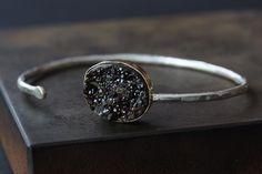 love this! Druzy Black Garnet Cuff Bracelet- 14kt gold, sterling silver, stacking bracelet, bezel, hammered, bangle, mixed metal. $295.00, via Etsy.