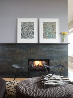 Contemporary fireplace with large scale metallic tile