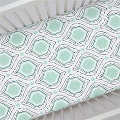 """Crib Fitted Sheet in and Mint and Navy Moroccan Damask by Carousel Designs.  Our fitted crib sheets feature deep pockets and have elastic all the way around the edges to hug mattresses securely. Fits standard crib mattresses, measuring approximately 28"""" x 52""""."""