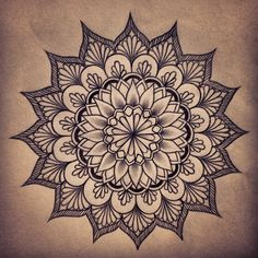 mandala tattoo on the nape of my neck