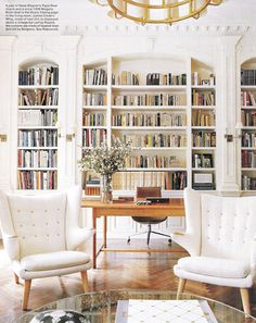 """1902 Manhattan townhouse.  """"A pair of Hans Wegner's Papa Bear chairs and a   circa-1938 Mogens Koch desk in the library.""""  Design by architects Lee Mindel and Peter Shelton of Shelton, Mindel and Associates."""