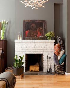 white brick fireplace, gray walls