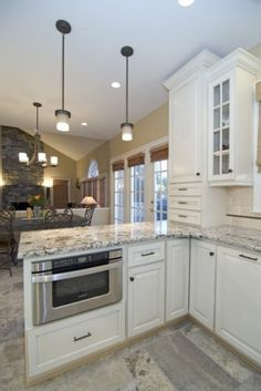 Love yhe counters and cabinets! Cant waaaaait to redo our kitchen! owning a home :-) kitchen peninsula