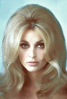 Sharon Tate If you do not know this is the young pregnant movie star that was murdered by Charles Mansan (sp).