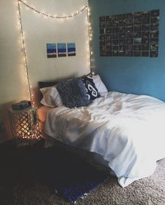The little split picture above the bed is a cute idea. Ties in the contrasting wall.