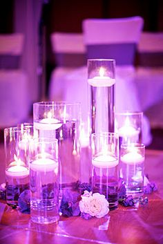 Centerpiece idea, all about lights, candles, mirrors, and sunken flowers in vases.. so beautiful