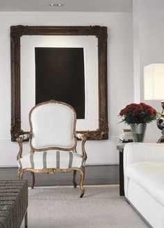 I love that this statement chair and huge frame have been used to create a French feel in this modern room.