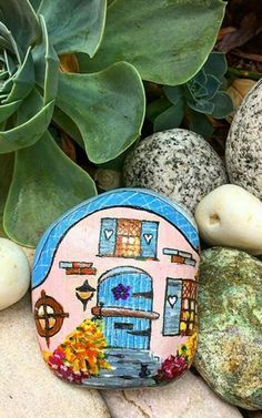 Pretty little cottage painted on stone!