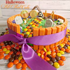 Halloween Kit Kat Cake, Ghostly Graveyard. A fun way to use up Halloween candy, or prepare for Halloween. Or even an awesome cake for a Halloween party! Great way to bake with kids too, as they love to help decorate the kit kat cake.