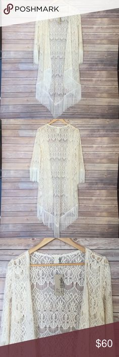 Beautiful Fringe Kimono Holiday Pick   Cream Fringe Kimono • Crochet Detail • By Moon Collection • Sleeves go down to elbows • Fringe on sleeves and at the bottom • Perfect to dress up or down • Works as a swim coverup • runs slightly small  Price is firm  New With Tags   The Naked Bohemian Boutique  Please, no trades, no low offers, and be kind. Moon Collection Sweaters Cardigans