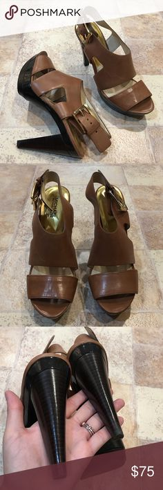 | Michael Kors | Carla Platform Sandals One of MK's signature heels! In excellent used condition. A few minor scratches to the leather but as expected. Leather upper. Rubber soles. MICHAEL Michael Kors Shoes Heels
