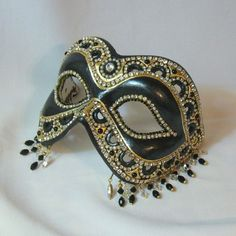 BejeweledMasquerade on Etsy rocks my socks.  That lady is so incredibly talented.