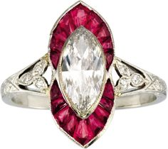 An Art Deco Diamond, Ruby, Platinum Ring, Black, Starr & Frost, Circa 1920. The ring centring a marquise-cut diamond weighing 0.93 carat, framed by fancy-shaped rubies, accented by single-cut diamonds, set in platinum. Marked B.S.& F. for Black, Starr & Frost. #BlackStarrFrost #ArtDeco #ring