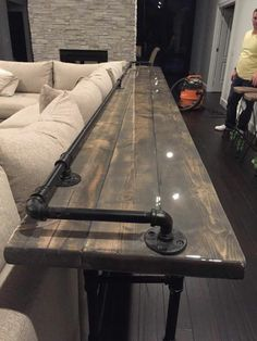 12' resin top bar with iron pipe base--- like the concept but I would add a piece of wood trim instead to help w spills... bc I have kids :)