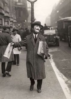 Selling newspapers, Paris, 1920s