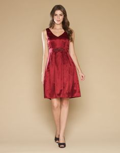 with net-trimmed underskirt for fullness. With v-neckline and concealed zip