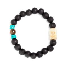"For the business man with an edge, the Billy Bracelet is strung of rugged dark wooden beads offset with smooth marbled turquoise. But the best part is the artistically carved ivory skull bead! - Wooden beads, turquoise and bone stone beads - 2.5"" diameter - Elastic stretch fit - Handcrafted"